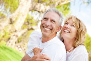 couple standing together smiling, macular degeneration, macular degeneration care, eye doctor Springfield MA, eye exam Western Ma