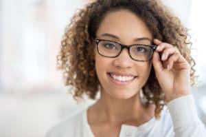 Woman wearing glasses looking at the camera, eye melanoma, eye exam Springfield MA, eye exam Western MA, eye doctor Springfield MA, eye doctor Longmeadow MA