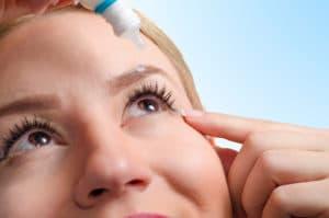 woman putting drops into her eyes, dry eye treatment Springfield MA, dry eye True Tear treatment, dry eye treatment services Western MA, True Tear dry eye treatment