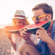 two people eating watermelon on the beach, healthy eye tips, eye exam Western MA, eye doctor Springfield MA