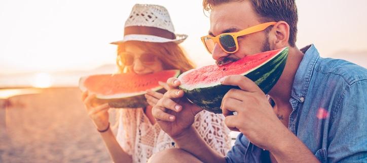 two people eating watermelon on the beach, healthy eye tips, eye exam Western MA, eye doctor Springfield MA