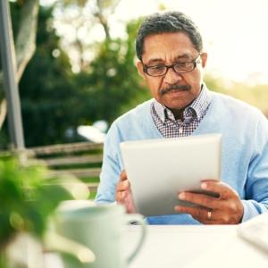man reading on a tablet, vision problems, eye exam Springfield MA, eye exam Western MA