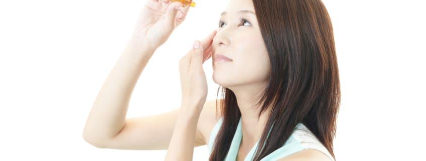 woman putting eye drop into eye, dry eye, dry eye syndrome, dry eye treatment, dry eye treatment Springfield MA