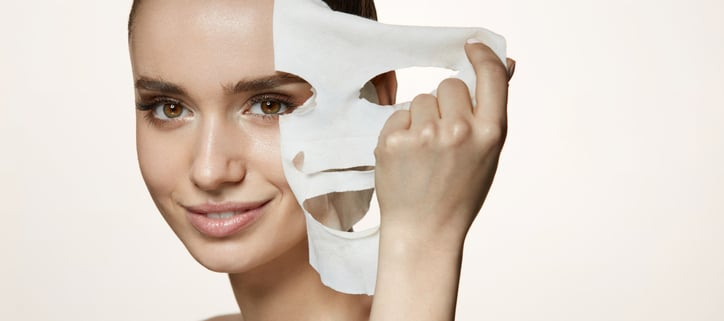 Woman smiling pulling fask mask off, Botox Cosmetic, Juvederm, cosmetic procedures western MA, Botox western MA, juvederm Western MA